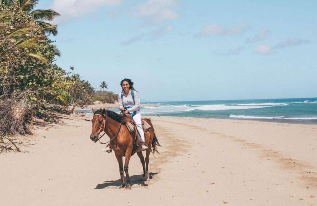 Horseback riding along the beach at Seahorse Ranch in  Cabarete.