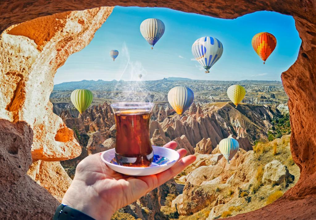Morning cup of tea with view of colorful hot air balloons flying