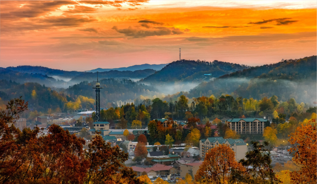 a view of the town of gatlinburg from afar with the mountain backdrop